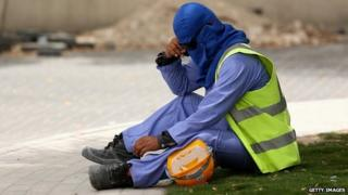 A construction worker takes a break in Qatar - 10 May 2014