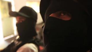 Masked members of drug cartel