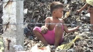 Boy on rubbish heap in Manila
