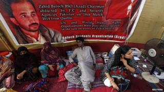 Latif Johar (C), 23, sits in a camp during a hunger strike demanding the release of Zahid Baloch outside Karachi's Press Club on 5 May 2014