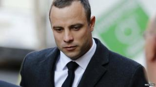 Olympic and Paralympic track star Oscar Pistorius arrives at the court