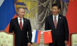 Russian President Vladimir Putin (left) with Chinese President Xi Jinping in Shanghai, China, 21 May