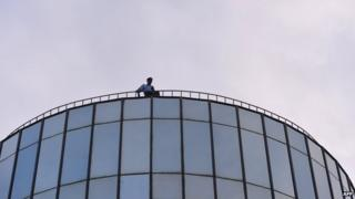Pakistani policeman on top of the Geo TV building in Islamabad on 30 April 2014