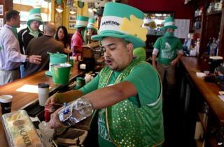 Bartender pours drink on St. Patrick's Day at The Gooses Acre Bistro and Irish Pub in The Woodlands, Texas