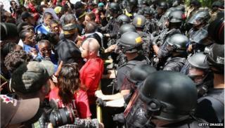 Protestors being met by police officers
