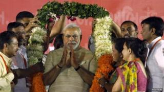 Narendra Modi being garlanded by supporters at a public meeting in the western city of Ahmedabad May 20, 2014.