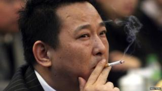 Liu Han, former chairman of Hanlong Mining, smokes a cigarette during a conference in Mianyang, Sichuan province, in this file picture taken 21 March 2008