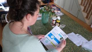 woman examines energy bill