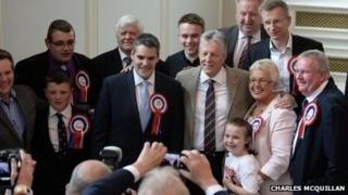Peter Robinson greets councillors at city hall