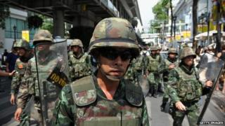 Thai army soldiers move out from a city centre anti-coup rally on 25 May 2014 in Bangkok, Thailand