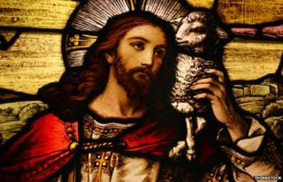 Stained glass of Jesus with lamb