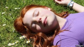 Woman asleep in meadow