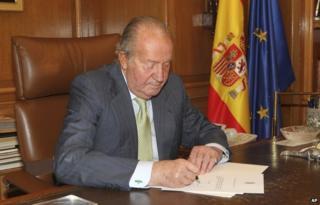 King Juan Carlos signs his abdication