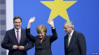 Jean-Claude Juncker (right) with Chancellor Merkel at CDU congress, 5 Apr 14