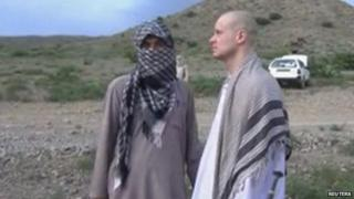 US Army Sergeant Bowe Bergdahl (right) waits before being released at the Afghan border