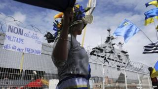 Demonstrator against Vladivostok warship at St Nazaire (1 June)
