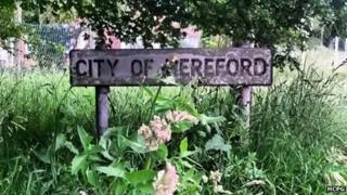 Overgrown City of Hereford sign