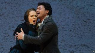 Vittorio Grigolo portrays Rodolfo with Kristine Opolais as Mimi in the Metropolitan Opera's Live in HD broadcast of Puccini's La Boheme, April 2014