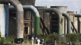 Forensic experts inspect the site of a explosion at Kosova A power plant in Obilic near Pristina on 6 June 2014.