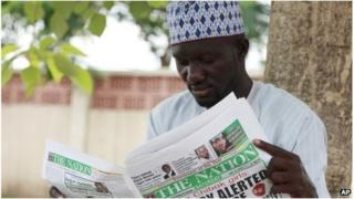 A man read the Nation in Abuja, Nigeria (10 May 2014)