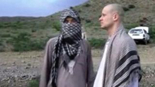 Sgt Bowe Bergdahl (right) stands with a Taliban fighter in eastern Afghanistan shortly before his release