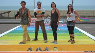 Heather Peace and the artists who created the rainbow crossing