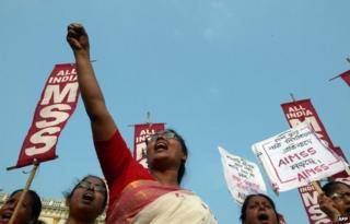 Indian activists from the Social Unity Center of India (SUCI) shout slogans against the state government in protest against the gang-rape and murder of two girls in the district of Badaun