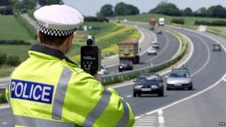 A police officer carrying out a speed check
