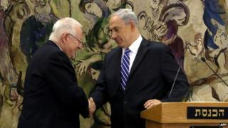 Israel's newly elected President Reuven Rivlin is greeted by Prime Minister Benjamin Netanyahu
