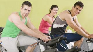 People on exercise bikes