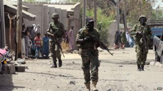 Nigerian troops patrolling the streets of the remote north-eastern town of Baga, Borno State (April 2014)
