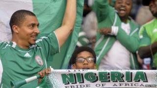 Nigeria fans cheer ahead of the international friendly soccer match between Nigeria and Scotland at Craven Cottage in London (May 2014)