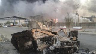 Burned-out military hardware after clashes in Mosul. 10 June 2014