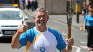 Former Scottish rugby captain Gavin Hastings carried the baton on the Royal Mile