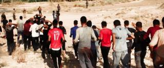 Photograph purportedly showing Iraqi soldiers being led towards militants from the Islamic State in Iraq and the Levant (ISIS) prior to their execution