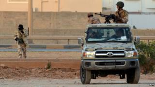Libyan men loyal to Gen Haftar during clashes against Islamists in Benghazi - 2 June 2014
