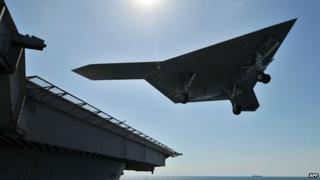 Unmanned aircraft leaves flight deck of aircraft carrier USS George HW Bush which has been ordered to the Gulf. May 2013