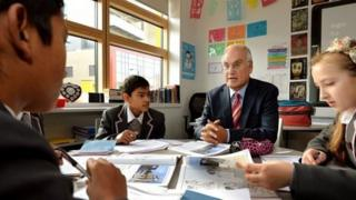 Sir Michael in a classroom