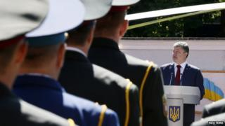Ukrainian President Petro Poroshenko attends a graduation ceremony at the National University of Defence in Kiev on 18 June