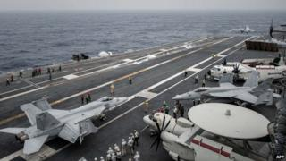US planes on the flight deck of USS George Washington. Photo: 15 June 2014