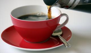 Cup of coffee being poured