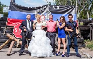 The Shevchenko family pose with weapons at a pro-Russian checkpoint