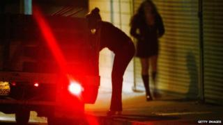A driver looks for prostitutes in Pomona, California