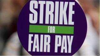 """Unison sign saying """"strike for fair pay"""""""