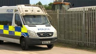 Police van at the waste management site