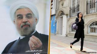 Woman in leggings passes poster of President Rouhani