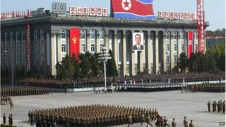North Korean soldiers parade in Pyongyang to mark the 60th founding anniversary of the ruling Workers' Party of Korea, Monday, Oct. 10, 2005