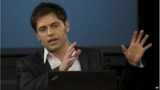 Argentina's Economy Minister Axel Kicillof talks to the media at a press conference to explain the recent U.S. Supreme Court's ruling on Argentina's bond default, in Buenos Aires, Argentina, Tuesday, June 17, 2014