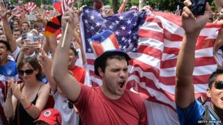 Fans cheer on the US football team during its World Cup match against Germany on 26 June.