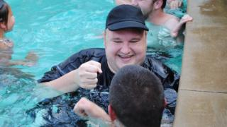 Kim Dotcom fistbumps a supporter